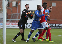 Fleetwood Town's Devante Cole closely marked by Oldham Athletic's goalkeeper Jack Ruddy (left) and Gevaro Nepomuceno as they wait for a corner kick<br /> <br /> Photographer Stephen White/CameraSport<br /> <br /> The EFL Sky Bet League One - Fleetwood Town v Oldham Athletic - Saturday 9th September 2017 - Highbury Stadium - Fleetwood<br /> <br /> World Copyright &copy; 2017 CameraSport. All rights reserved. 43 Linden Ave. Countesthorpe. Leicester. England. LE8 5PG - Tel: +44 (0) 116 277 4147 - admin@camerasport.com - www.camerasport.com