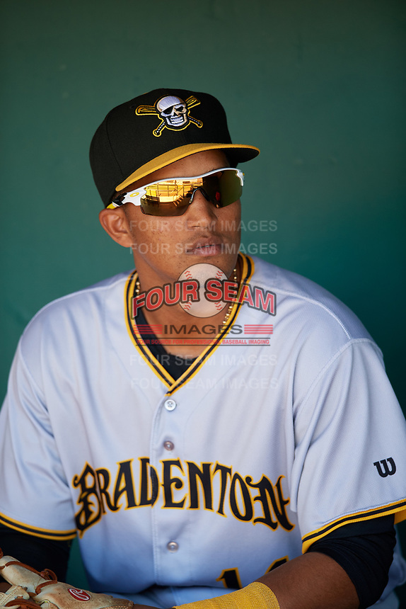 Bradenton Marauders shortstop Adrian Valerio (14) in the dugout before the first game of a doubleheader against the Lakeland Flying Tigers on April 11, 2018 at Publix Field at Joker Marchant Stadium in Lakeland, Florida.  Lakeland defeated Bradenton 5-4.  (Mike Janes/Four Seam Images)