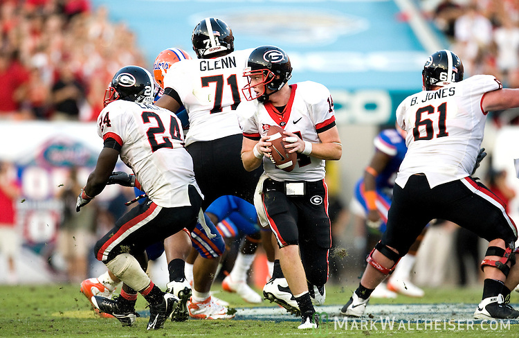 Georgia quarterback Joe Cox (14) rolls out of the pocket looking for a receiver in the 2nd half of the Florida Gators 41-17 victory over the Georgia Bulldogs in Jacksonville, Florida October 31, 2009.  Cox's pass resulted in an interception.