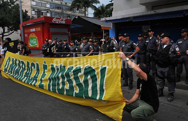 """Demonstrators participate in a protest in Rio de Janeiro, Brazil, 30 June, 2013. Around 4,000 people gathered to denounce corruption, poor public services despite a heavy tax burden, and also the billions of dollars spent to host the World Cup and the 2016 Olympics in Rio - money they say should be going toward better hospitals, schools, transportation projects and schools. In the banner says: """"The Maraca (Maracana) is our"""" (Austral Foto/Renzo Gostoli)"""