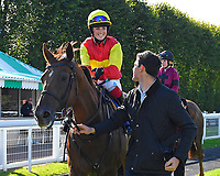 Winner of The Mercedes-Benz of Salisbury Handicap (For Lady Amateur Riders) Relight My Fire  ridden by Emily Easterby and trained by Tim Easterby is led into the winners enclosure during Twilight Racing at Salisbury Racecourse on 14th September 2018