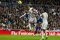 Real Madrid´s Karim Benzema and Raphael Varane and Deportivo de la Coruna's Albert Lopo during 2014-15 La Liga match between Real Madrid and Deportivo de la Coruna at Santiago Bernabeu stadium in Madrid, Spain. February 14, 2015. (ALTERPHOTOS/Luis Fernandez) /NORTEphoto.com