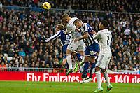 Real Madrid´s Karim Benzema and Raphael Varane and Deportivo de la Coruna's Albert Lopo during 2014-15 La Liga match between Real Madrid and Deportivo de la Coruna at Santiago Bernabeu stadium in Madrid, Spain. February 14, 2015. (ALTERPHOTOS/Luis Fernandez) /NORTEphoto.com