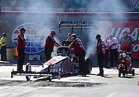 Oct. 27, 2012; Las Vegas, NV, USA: NHRA crew members for top fuel driver Chris Karamesines during qualifying for the Big O Tires Nationals at The Strip in Las Vegas. Mandatory Credit: Mark J. Rebilas-