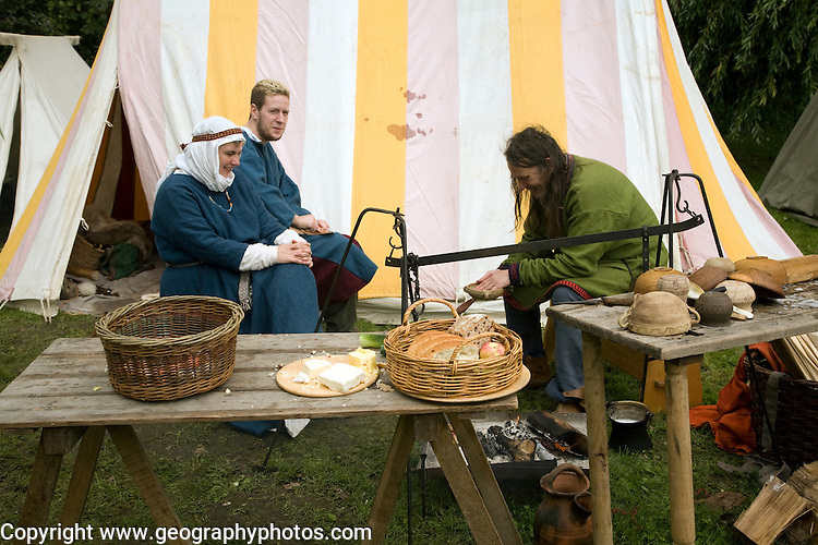 Family group eating Historical re-enactment Saxon, Viking, Norman history, Woodbridge, Suffolk