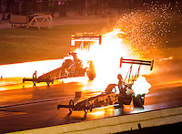 Oct 14, 2016; Ennis, TX, USA; NHRA top fuel driver Scott Palmer (far) has an engine fire alongside Troy Buff during qualifying for the Fall Nationals at Texas Motorplex. Mandatory Credit: Mark J. Rebilas-USA TODAY Sports