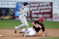 Tri-City Valleycats Kike Hernandez (7) attempts to turn a double play as Chris Edmondson slides in during game three of the NYPL Semifinals vs. the Batavia Muckdogs at Dwyer Stadium in Batavia, New York September 9, 2010.   Tri-City defeated Batavia 1-0.  Photo By Mike Janes/Four Seam Images