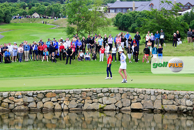 Olivia Mehaffey and Hannah O'Sullivan on the 17th during Sunday Singles matches at the 2016 Curtis cup from Dun Laoghaire Golf Club, Ballyman Rd, Enniskerry, Co. Wicklow, Ireland. 12/06/2016.<br /> Picture Fran Caffrey / Golffile.ie<br /> <br /> All photo usage must carry mandatory copyright credit (&copy; Golffile | Fran Caffrey)