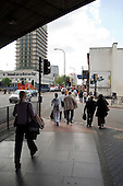 Pedestrians walk beneath the Westway flyover on the Edgware Road, London.