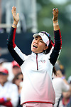 DES MOINES, IA - AUGUST 18: USA's Danielle Kang revs up the crowd on the first hole Friday morning at the 2017 Solheim Cup in Des Moines, IA. (Photo by Dave Eggen/Inertia)