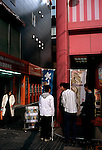 Young boys hang out near Comic Toranoana, one of the largest chains of manga comic bookstores in Japan and a multi-story video game complex.  Akihabara is considered a mecca for manga fans and otakus, and hundreds spend their days there at the many video game parlours,  comic books stores, and maid cafes.