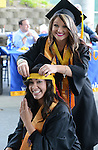 Nursing graduates Stephanie Pruitt, top, and Jesseca Pacheco, get ready for  the 2015 Western Nevada College Commencement held at the Pony Express Pavilion in Carson City, Nev., on Monday, May 18, 2015.<br /> Photo by Tim Dunn