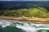Aerial view looking over Ninety Mile Beach to the exotic Aupouri Forest with Houhora Harbour in the far distance. Far North, Northland, New Zealand.