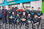 Vincent Devlin from Centra Cahersiveen making a presentation of a new kit to Sean O'Sullivan of Iveragh Eagles pictured here front l-r; Jack Landers, Thomas Hussey, Shane Mulvihill, Shane Coffey, Pádraig O'Connell, back l-r; Nealie Lyne, Gearóid Riordan, Liam King, Sean O'Sullivan, Vincent Devlin(Centre), David Hussey, Jack O'Sullivan, Luke Kennedy & Conchubhair Guiney.