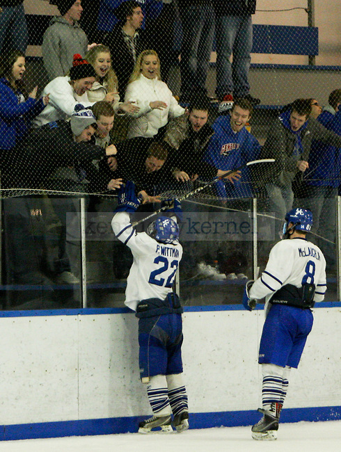UK senior Pat Wittman celebrates with the fans after scoring a big goal during the UK men's club hockey game against The Ohio State University at the Lexington Ice center in Lexington, Ky., on Saturday, January, 18, 2014. Photo by Jonathan Krueger | Staff