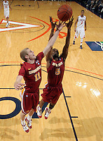 Dec. 30, 2010; Charlottesville, VA, USA; Iowa State Cyclones guard Darion 'Jake' Anderson (5) grabs the rebound next to Iowa State Cyclones guard Scott Christopherson (11) during the game against the Virginia Cavaliers at the John Paul Jones Arena. Iowa State Cyclones won 60-47. Mandatory Credit: Andrew Shurtleff-