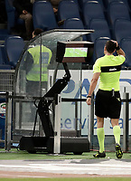 Calcio, Serie A: Roma, stadio Olimpico, 11 dicembre 2017.<br /> The referee Piero Giacomelli is watching the VAR during the Italian Serie A football match between Lazio and Torino at Rome's Olympic stadium, December 11, 2017.<br /> UPDATE IMAGES PRESS/Isabella Bonotto