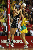 16.11.2007 Australian Sharelle McMahon and Silver Ferns Casey Williams in action during the Silver Ferns v Australia Final at the New World Netball World Champs held at Trusts Stadium Auckland New Zealand. Mandatory Photo Credit ©Michael Bradley. ***FREE FOR EDITORIAL USE***