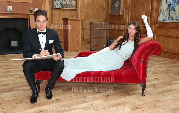 Mario Falcone and Lucy Mecklenburgh opening a replica of Rose's cabin at Westfield London to launch the release of Titanic on Blu-ray and Blue-ray 3D, London, England. 11/09/2012 Picture by: Henry Harris / Featureflash.