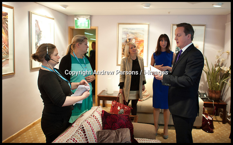 British Prime Minister David Cameron in the green room with his wife Samantha Cameron and members of staff before delivering his speech to delegates on the last day of the Conservative party conference, International Convention Centre, October 10, 2012, Birmingham, England. Photo by Andrew Parsons / i-Images...