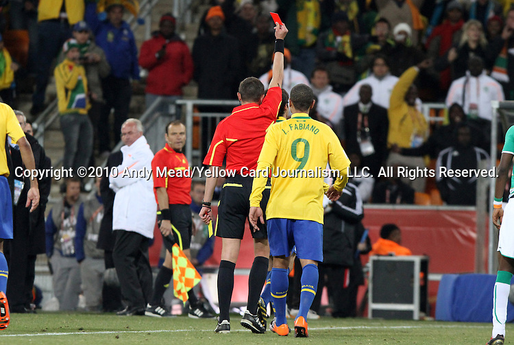 20 JUN 2010: Referee Stephane Lannoy (FRA) shows the red card to Kaka (BRA) (behind) as Luis Fabiano (BRA) (9) and C'ote d'Ivoire head coach Sven Goran Eriksson (SWE) (in white) watch. The Brazil National Team defeated the C'ote d'Ivoire National Team 3-1 at Soccer City Stadium in Johannesburg, South Africa in a 2010 FIFA World Cup Group G match.