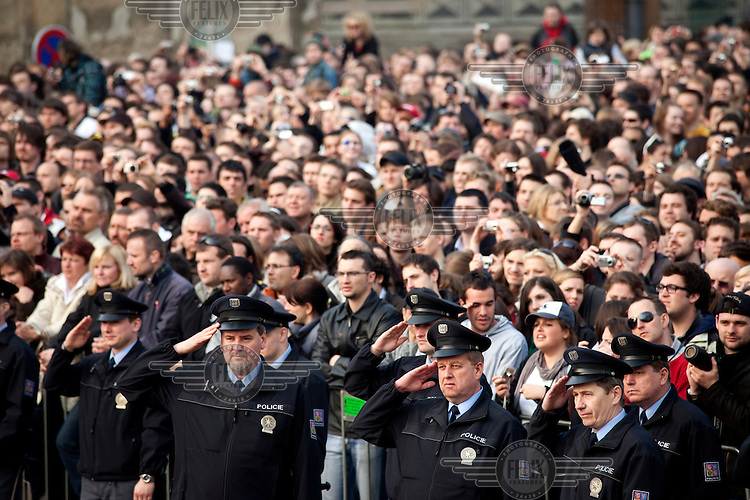 Policemen salute during the Czech national anthem before Barack Obama's speech, which he gave to a packed Hradcanske square, in front of Prague Castle.