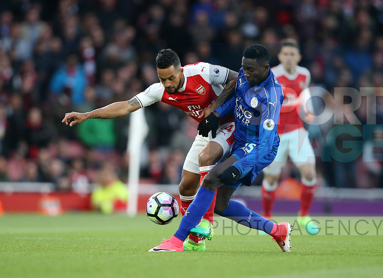 Arsenal's Theo Walcott tussles with Leicester's Wilfred Ndidi during the Premier League match at the Emirates Stadium, London. Picture date: April 26th, 2017. Pic credit should read: David Klein/Sportimage