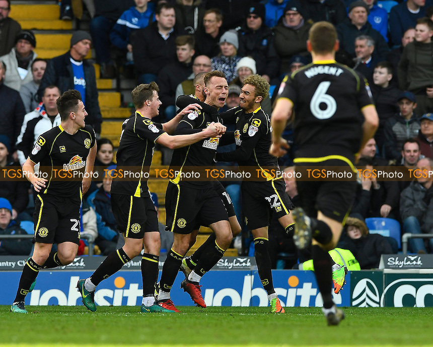 Goalscorer George Ray of Crewe Alexandra is mobbed by team matesi during Portsmouth vs Crewe Alexandra, Sky Bet EFL League 2 Football at Fratton Park on 4th March 2017