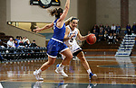 SIOUX FALLS, SD - NOVEMBER 15: South Dakota State Jackrabbits's Lindsey Theuninck #3 drives to the basket against Kynedi Cheeseman #30 from Dakota Wesleyan during their game Friday evening at the Sanford Pentagon in Sioux Falls, SD. (Photo by Dave Eggen/Inertia)