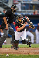 Batavia Muckdogs catcher David Gauntt (46) retrieves the ball as umpire Dane Ponczak looks on during a game against the West Virginia Black Bears on June 28, 2016 at Dwyer Stadium in Batavia, New York.  Batavia defeated West Virginia 3-1.  (Mike Janes/Four Seam Images)