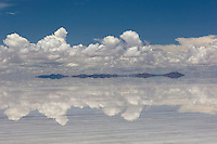 The salt flats of Uyuni in Bolivia (Salar de Uyuni) consist of a solid salt cap whose thickness varies from a few tens of centimetres to several metres. Beneath it is a lake of saturated salt and mineral solutions that varies in depth between 2m and 20m. Leaving aside the factual information, though, it is a place of stunning natural beauty, especially during the summer months when the flats are covered in several inches of water and everywhere you look there is an almost perfect reflection.