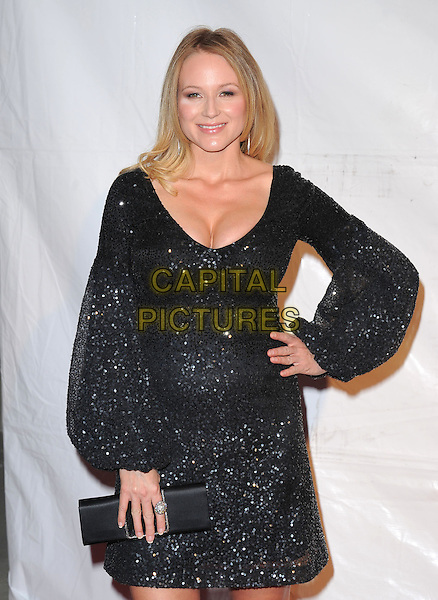 JEWEL KILCHER .at The 2011  MusiCares Person of the Year Dinner at the Los Angeles Convention Center, West Hall in Los Angeles, California, USA, .February 11th 2011..half length black dress long sleeve hand on hip  clutch bag sequined sequin beaded sparkly .CAP/RKE/DVS.©DVS/RockinExposures/Capital Pictures.