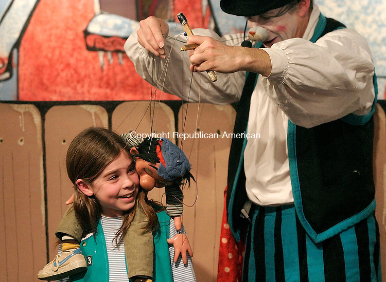 TORRINGTON, CT - 06 MARCH 2005 - 030605JS01--Puppeteer Michael Wolski as his character  William K. Whiskers, has fun with Emma Williams, 9, of Goshen while working his marionette Billy Take the Garbage Out during a show at Artwell in Torrington in Sunday. The show was part of Artwell's Kid's Stuff program--Jim Shannon Photo --Michael Wolski; William K. Whiskers; Emma Williams, Artwell, Torrington are CQ