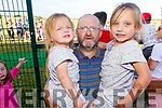 Michael, Vanessa and Katie Coonan enjoying the Pig racing in the Ballyheigue GAA field on Thursday.