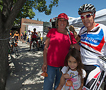 Patricia Schilder, Mike and 4-year old Mikylla McMurry at the Tour De Nez Bike Race in downtown Reno on Saturday, June 11, 2016.