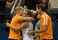 Moskou, Russia, Februari 4, 2016,  Fed Cup Russia-Netherlands, Richel Hogenkamp (NED) jis congratulated by captain Paul Haarhuis and fellow player Kiki Bertensafter defeating Kuznetsova, Netherlands lead 2-0<br /> Photo: Tennisimages/Henk Koster