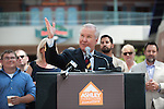Tampa Mayor Bob Buckhorn welcomes Ashley Furniture to the ribbon cutting of their headquarters in Ybor City.