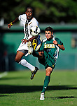 1 September 2009: Siena College Saints' midfielder Steve Covino (11), a Junior from Bristol, CT battles University of Vermont Catamount forward/midfielder T.J. Gore (7), a Senior from Macomb, MI, at Centennial Field in Burlington, Vermont. The Saints edged out the Catamounts 1-0. Mandatory Photo Credit: Ed Wolfstein Photo