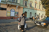 Woman with shopping in a cobbled street in Lviv.