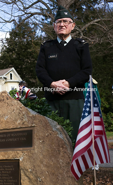 Woodbury, CT- 08 November 2015-110815CM06-  Fred Holzbaur of  Woodbury and a U.S Army veteran listens in during a ceremony at the Woodbury Cannon Green on Sunday. Town leaders and veterans groups held a ceremony in honor of Veterans Day, which will Wednesday, November 11.      Christopher Massa Republican-American