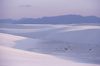 SAND DUNES<br /> (Variations Available)<br /> Dome Shaped Dunes, White Sands Nat. Monument<br /> <br /> The dunes are formed of gypsum.  Deposits of selenite crystals are broken down into sand sized grains due to weather erosion. Prevailing wind carries the grains away forming constantly shifting dunes.