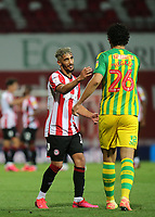 Said Benrahma of Brentford consoles Ahmed Hegazi of West Brom after the Baggies were beaten 1-0 during Brentford vs West Bromwich Albion, Sky Bet EFL Championship Football at Griffin Park on 26th June 2020