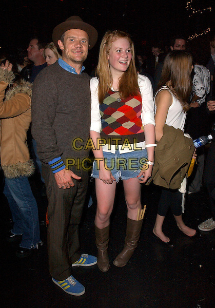 FLEA (Red Hot Chili Peppers) & CLARA (The Tints).At The Tints  concert live at The Key Club in West Hollywood, California, USA, December 2nd 2004..The Tints' drummer, Clara, is the daughter of Flea from the Red Hot Chili Peppers..full length father daughter drum sticks in knee high brown boots.**EXCLUSIVE**.Ref: DVS.www.capitalpictures.com.sales@capitalpictures.com.©Debbie VanStory/Capital Pictures .