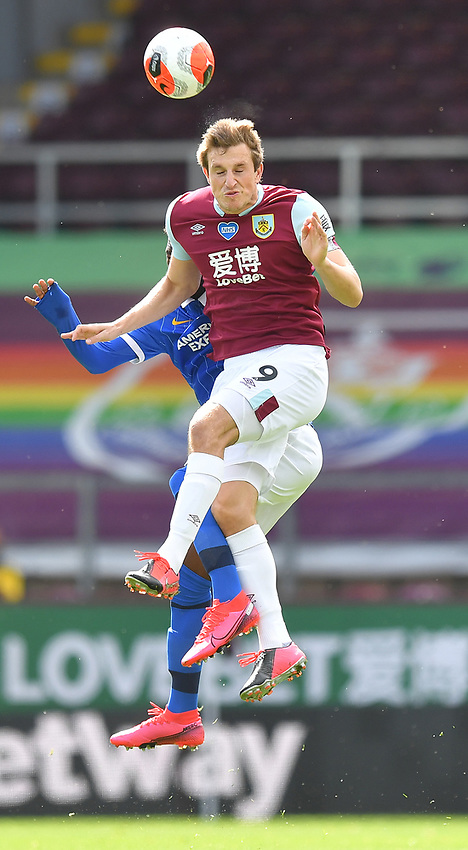 Burnley's Chris Wood out jumps Brighton & Hove Albion's Yves Bissouma<br /> <br /> Photographer Dave Howarth/CameraSport<br /> <br /> The Premier League - Burnley v Brighton & Hove Albion - Sunday 26th July 2020 - Turf Moor - Burnley<br /> <br /> World Copyright © 2020 CameraSport. All rights reserved. 43 Linden Ave. Countesthorpe. Leicester. England. LE8 5PG - Tel: +44 (0) 116 277 4147 - admin@camerasport.com - www.camerasport.com