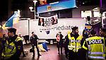 Solna 2014-10-09 Fotboll EM-kval , Sverige - Ryssland :  <br /> Personer med Ukrainaflaggor och ett plakat med texten &quot;Red Card Putin&quot; utanf&ouml;r Friends Arena innan matchen mellan Sverige och Ryssland protesterar mot att Ryssland arrangerar VM 2018 <br /> (Photo: Kenta J&ouml;nsson) Keywords:  Sweden Sverige Friends Arena EM Kval EM-kval UEFA Euro European 2016 Qualifier Qualifiers Qualifying Group Grupp G Ryssland Russia supporter fans publik supporters polis poliser protest protestera protsterar demonstrera demonstrerar demonstration