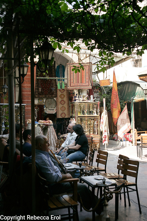 Relaxing and smoking the hookah pipe in the courtyard of the Corlulu Ali Pasa Medresesi, Istanbul, Turkey