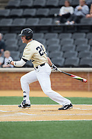 Gavin Sheets (24) of the Wake Forest Demon Deacons follows through on his swing against the Georgia Tech Yellow Jackets at David F. Couch Ballpark on March 26, 2017 in  Winston-Salem, North Carolina.  The Demon Deacons defeated the Yellow Jackets 8-4.  (Brian Westerholt/Four Seam Images)