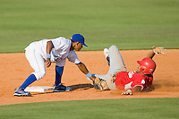 Second baseman Luis Piterson #8 of the Burlington Royals applies the tag to a Kernersville Bulldogs runner in an exhibition game at Burlington Athletic Stadium June20, 2010, in Burlington, North Carolina.  Photo by Brian Westerholt / Four Seam Images