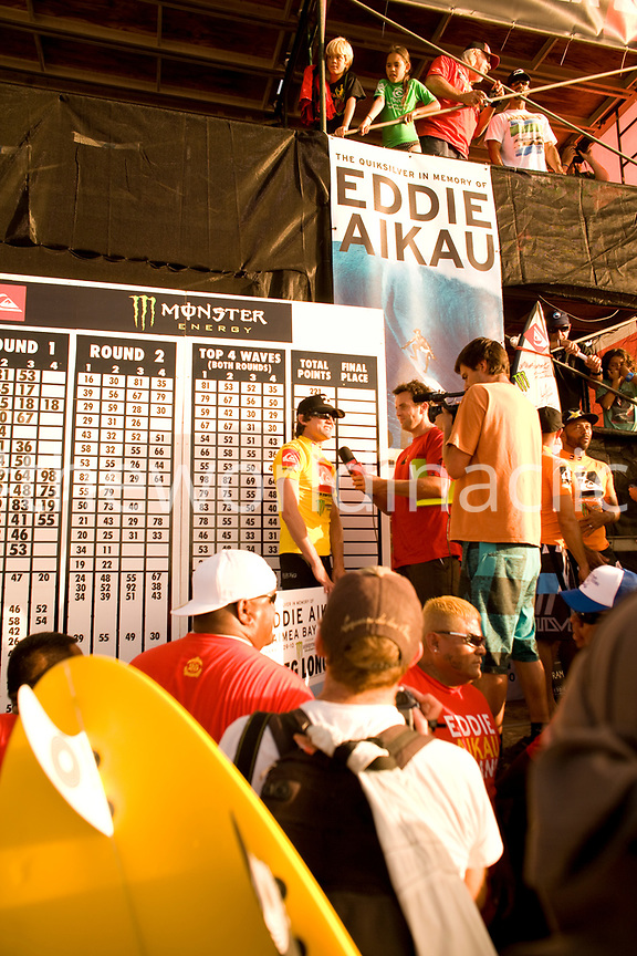 USA, Hawaii, Oahu, surfer Greg Long receives his award after winning the Eddie Aikau, Waimea Bay