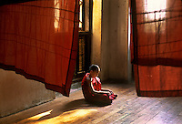 Burma/Myanmar 2005.Meditating monk in Sagain. In this predominately Buddhist country, every Burmese male is expected to take temporary monastic vows twice in his life: once as a samanera or novice monk between ages five and fifteen and again as a pongyi sometime after twenty. Some spend between a few days and three months; others are ordained for life.